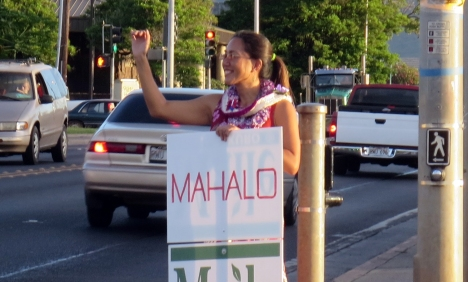 """Mahalo for all your support!"" said Senator Maile Shimabukuro. ""We wouldn't have been able to do it without your generous donations, tireless efforts, and kind and encouraging words throughout the campaign. During sign-waving, we really appreciated your smiles, shakas, waves, and toots as you drove by. For those who allowed me to post campaign signs on their property, a big mahalo! As a community, we have a lot of problems facing us, and I look forward to working with all of you to address them."" Photo of Maile on Farrington Highway and Wai'anae Valley Road on the day after the General Election, 5 Nov. 2014."